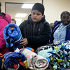 BEN MIKESELL | THE GOSHEN NEWS<br /> Jonathan Rios, a Chamberlain Elementary School fourth-grader, drops off a fleece blanket Tuesday at The Salvation Army. Chamberlain students made 75 blankets to be delivered as part of Mayor Jeremy Stutsman's Year of Goodness initiative.