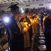 Roger Schneider   The Goshen News<br /> Fairfield graduates continue the tradition of holding artificial candles at the end of the graduation ceremony Sunday.