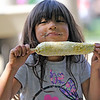 Roger Schneider | The Goshen News<br /> Sasha Tores, 5, of Goshen, got a little messy Saturday at the Goshen Multicultural Festival while eating some Mexican street corn.
