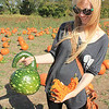 Roger Schneider | The Goshen News<br /> Lisa Dabrowski, Granger, holds some gourds she selected at Kercher's Sunrise Orchard and Farm Market Saturday during the fall harvest festival.
