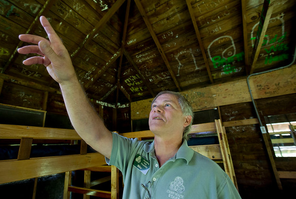 JAY YOUNG | THE GOSHEN NEWS<br /> Mike Kauffman, who is the guest services director at Camp Mack, points out some of the names that children have left on the ceiling in one of the camp houses Tuesday morning. After over thirty years, Kauffman is retiring.