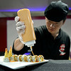 BEN MIKESELL | THE GOSHEN NEWS<br /> Chef Sean Gao prepares a sushi dish Friday during Miso Japan Hibachi Grill & Sushi's grand opening at 203 W Pike Street in Goshen. Owner Bella Lin takes pride in presenting sushi as an art.