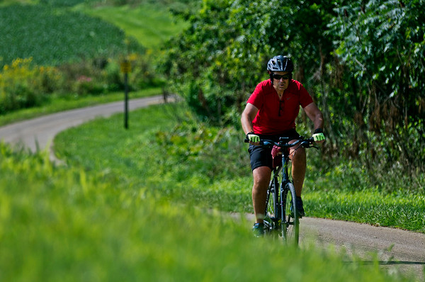 JAY YOUNG   THE GOSHEN NEWS<br /> A cyclist makes his way east along the Pumpkinvine Trail near mile marker three Friday morning.