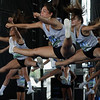 JAY YOUNG | THE GOSHEN NEWS<br /> Cheerleaders with Indiana Ultimate perform a demonstration routine during the 44th annual cheerleading contest that is part of the Elkhart County 4-H Fair Friday afternoon. Three cheer squads took part in the competitive portion of the event, with Concord taking first place, Wawasee High taking second place and Oregon-Davis High placing third. John Adams High was also on hand as the only squad competing in the spirit squad portion of the event. Other activities included a jump off and demonstrations by Indiana Ultimate.