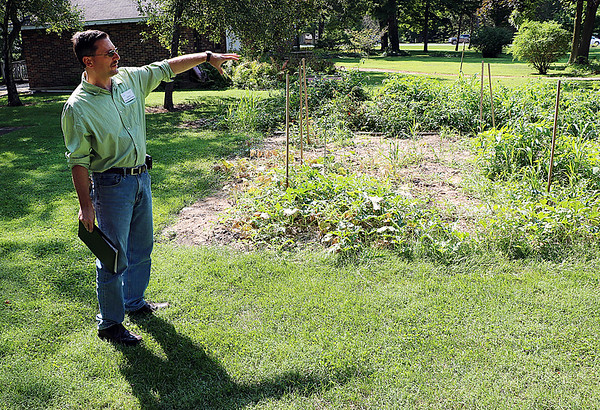 JOHN KLINE | THE GOSHEN NEWS<br /> Calvin Swartzendruber, a chemistry and physics teacher at Bethany Christian Schools, points to the school's student-run garden during a tour of the school's sustainability efforts early Friday afternoon. The tour was part of a celebration announcing the school's recent selection as a 2017 U.S. Department of Education Green Ribbon Schools award winner.