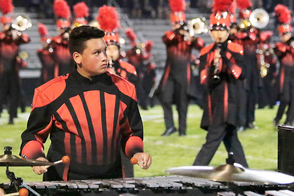 "Marco Lazaro keeps in time with the drum major during Goshen's show ""Pyromania"" played at Concord's invitational."