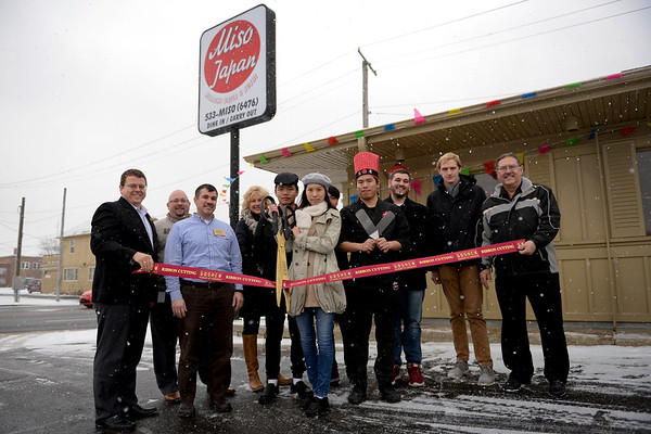 BEN MIKESELL | THE GOSHEN NEWS<br /> Bella Lin and her fiancé Tim Wu cut the ribbon surrounded by Goshen Chamber ambassadors Friday to announce the opening of their new sushi restaurant, Miso Japan Hibachi Grill & Sushi, at 203 W Pike Street in Goshen.