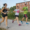 JAY YOUNG | THE GOSHEN NEWS<br /> From left, Rebekah Whirledge, Dani Miller and Tyler Miller, all of Goshen, run down the Millrace Trail during The Goshen Brewery Company's weekly Goshen Millrace Dam Beer Run  Thursday evening. Every Thursday at 6 p.m. runners meet outside the brewery and run to the dam and back, about four miles. Afterwards, the runners meet up and enjoy drinks at the brewery. The runs are free and open to the public.