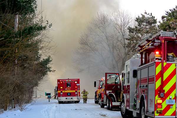 BEN MIKESELL | THE GOSHEN NEWS<br /> Smoke billows across C.R. 40 from a house fire Tuesday morning in Goshen. The fire started in the garage behind the house and quickly spread to the rest of the home.