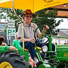 LEANDRA BEABOUT | THE GOSHEN NEWS<br /> Leroy Slabach of Nappanee rolled his John Deere tractor down Market St. during the parade.