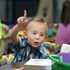 JULIE CROTHERS BEER | THE GOSHEN NEWS<br /> Kindergartner Owen Lehman points to the ceiling Wednesday as he hears Nappanee Elementary School Principal Randy Cripe's voice echo through the room from the loudspeaker during the morning announcements.