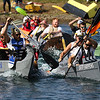 JAY YOUNG | THE GOSHEN NEWS<br /> Adam Arsenault, front left, and teammate Michael Arsenault, with Jamil Packaging, fight for first place in the championship race against the team from Bail Home Services and Construction, consisting of Matt Hershberger, front, and Randy Rock during the United Way's Great Cardboard Boat Race Friday afternoon at the LaSalle Bristol Pond in Elkhart.