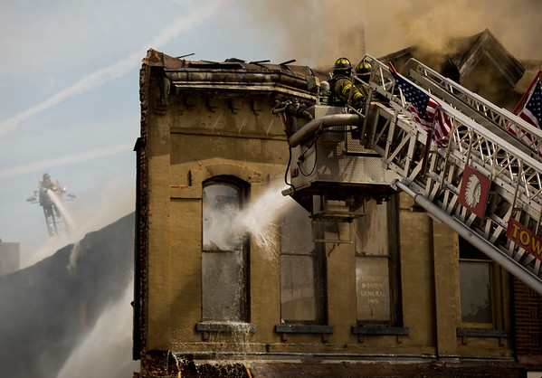 JAY YOUNG   THE GOSHEN NEWS<br /> Multiple aerial trucks battle a large fire in downtown LaGrange Tuesday afternoon.