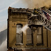 JAY YOUNG | THE GOSHEN NEWS<br /> Multiple aerial trucks battle a large fire in downtown LaGrange Tuesday afternoon.