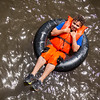 JAY YOUNG | THE GOSHEN NEWS<br /> Ten-year-old Trenton Bias, of Elkhart, lays back as he gently floats down the Elkhart River in an inner tube Saturday afternoon during the Rhapsody in Green Music Festival at Island and Bisentennial Parks in Elkhart.