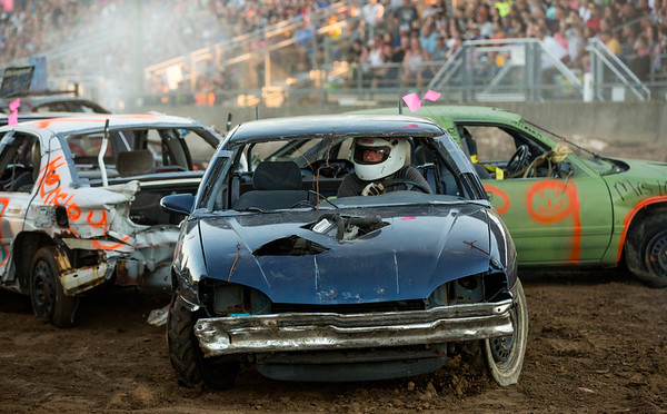 JAY YOUNG | THE GOSHEN NEWS<br /> Drivers compete during the demolition derby Saturday evening at the Elkhart County 4-H Fair.