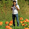 Roger Schneider | The Goshen News<br /> Daniel Montiel of Goshen holds his daughter Julissa, 1, on his shoulders while he walks through the pumpkin patch Saturday at Kercher's Sunrise Orchard and Farm Market in Goshen.