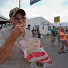 JAY YOUNG | THE GOSHEN NEWS<br /> Vietnam veteran Bob King, of LaPorte, enjoys a bite of funnel cake at the Elkhart County 4-H Fair Friday evening.  Friday was Veteran's Day at the fair and veterans were admitted free.