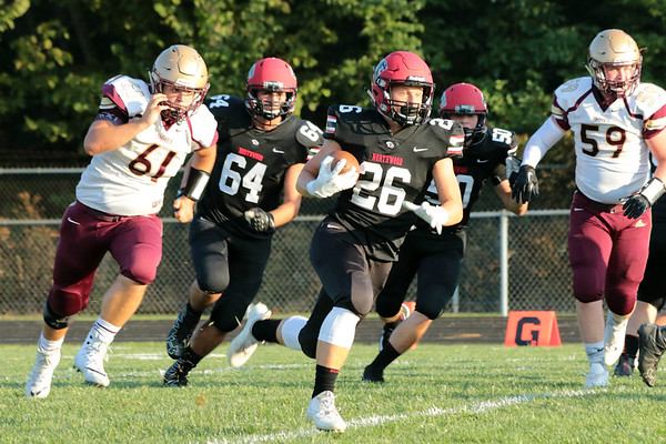 Stacey Diamond | The Goshen News<br /> Northwood's Brayton Yoder, 26, begins a 91-yard touchdown carry for the Panther's first score of the night against Jimtown.