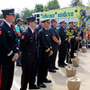 ADAM RANDALL | THE GOSHEN NEWS<br /> Fire department representatives from Goshen, Elkhart, Nappanee, Jefferson Township, Osolo Township, Baugo Township, South Bend and Notre Dame, were presented trees at Concord Fire Department No. 1's 9/11 ceremony Monday.
