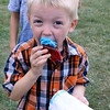 SHERRY VAN ARSDALL | THE GOSHEN NEWS<br /> Aedan Wolford, 5, of Goshen, enjoys his cupcake during the 50th celebration of Elkhart County Parks at Ox Bow County Park in Dunlap Sunday afternoon.