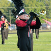 Hudson Branch plays the trumpet for the Red Regiment of NorthWood,  while performing at the Concord invitational.