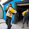BEN MIKESELL | THE GOSHEN NEWS<br /> Alan Cundiff of Scott carries chicken feed with the help of Jack's Feed Shack owner Jessica Watson Thursday in Bristol.