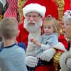BEN MIKESELL | THE GOSHEN NEWS<br /> Lexi Leininger, 2, of Mishawaka sits on Santa's lap Dec. 9 at Linton's Enchanted Gardens.