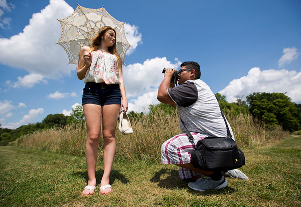 JAY YOUNG | THE GOSHEN NEWS<br /> Alaina Buttermore poses while Kevin Almodovar works the camera Wednesday afternoon at Oxbow Park. The two said they like to use the park for photography shoots because of its scenic areas.