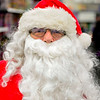 BEN MIKESELL | THE GOSHEN NEWS<br /> Bob Deveau of Goshen, has been donning the Santa outfit for 40 years. He works at the Walmart on Elkhart Road putting together bicycles.