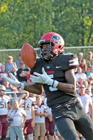 Stacey Diamond | The Goshen News<br /> Northwood's DeAndre Smart eyes the ball while making a catch in first half play against Jimtown at Northwood Friday night.