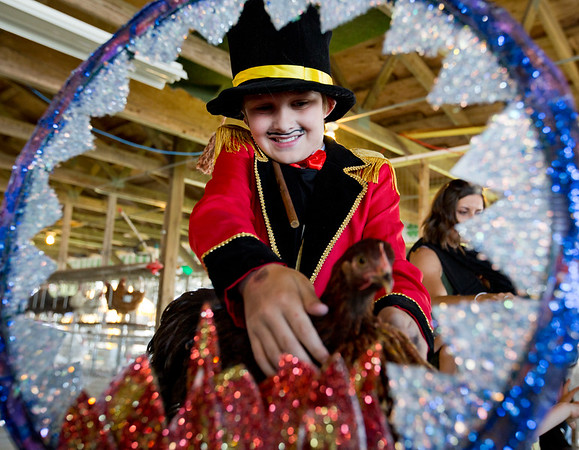 JAY YOUNG | THE GOSHEN NEWS<br /> Eleven-year-old Hunter Ambrosen, of Jones, Michigan, shows off his chicken tamer costume with his chicken named Stingray Tuesday afternoon in the poultry barn at the Elkhart County 4-H Fair.