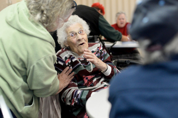 BEN MIKESELL | THE GOSHEN NEWS<br /> Dorothy Landon of Bristol greets family members while celebrating her 100th birthday Thursday at the Salvation Army in Goshen. Landon turns 100 on Dec. 12, but celebrated with friends and family a week early.