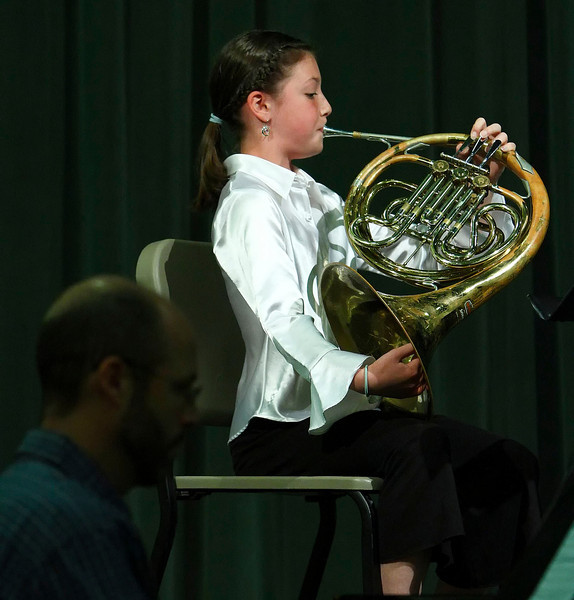 Ten-year-old Mae Burris-Wells plays a selection by Brahms on the french horn while accompanied on piano by her father, Brad Wells.  The duo performed as part of benefit concert put on by Williamstown Elementary School children to benefit the school's fifth grade band.  Williamstown, 5/16/10 - Ian Grey