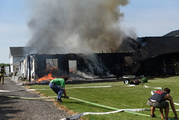Ben Mikesell | The Goshen News<br /> A house at 11230 C.R. 34 east of Goshen between C.R.s 41 and 43 is burning this morning. Firefighters from Clinton, Benton and Elkhart townships were called to the fire around 9:45 a.m. The Goshen News will have more information as it become available.