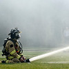 BEN MIKESELL   THE GOSHEN NEWS<br /> Clinton Township Fire Fighter Brian Borkholder sprays water on a house fire Tuesday morning at 11230 C.R. 34 east of Goshen.