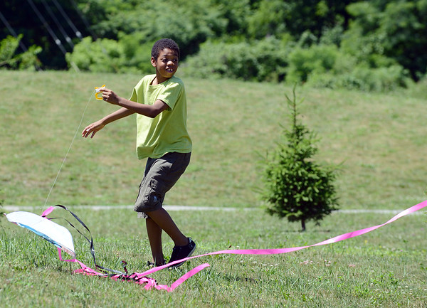 HALEY WARD | THE GOSHEN NEWS<br /> Jay'Briel Stokes runs to get a kite in the air on Monday at Allan J. Kauffman Park. He came with his siblings where they found the kite abandoned and fixed it up.