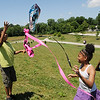 HALEY WARD | THE GOSHEN NEWS <br /> Jay'Briel Stokes, Jay'Brianna Stokes and Jay'Vonte Bryant fly a kite on Monday at Allan J. Kauffman Park. The siblings who live near the park found the kite abandoned and fixed it up.