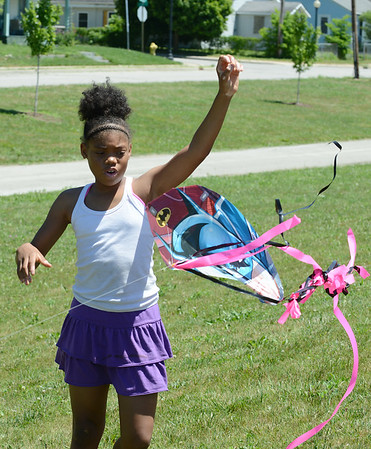 HALEY WARD | THE GOSHEN NEWS<br /> Jay'Brianna Stokes lets go of a kite on Monday at Allan J. Kauffman Park. She came with her siblings where they found the kite abandoned and fixed it up.