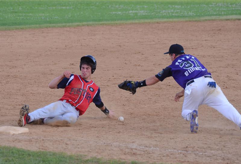 North Adams' Jake Hall slides into third base as Tyler Aces' Joe DiMassimo can't handle the throw. (Gillian Jones/North Adams Transcript)