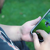 HALEY WARD | THE GOSHEN NEWS <br /> Tobias Garcia, 16, Goshen, attempts to catch a Pokémon while playing Pokémon Go on Thursday outside the Elkhart County Courthouse.