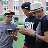 HALEY WARD | THE GOSHEN NEWS <br /> Alen Perez, Steve Perez and Victor Moreno play Pokémon Go on Thursday outside the Elkhart County Courthouse.