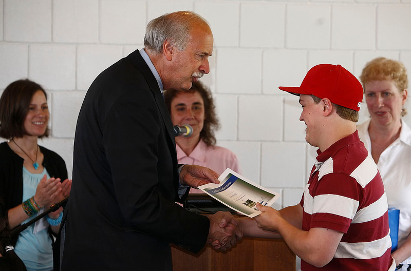BCC President, Doctor Paul Raverta, presents Steven Beagle with a certificate of acheivement for the Positive Options Program on Friday at the college.  Pittsfield, 5/28/10 - Ian Grey