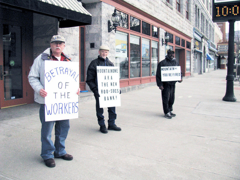 Jennifer Huberdeau/North Adams Transcript<br /> John Armstrong, Mike WIlbur and Mark Parris stood outside Hoosac Bank on Monday in protest of staffing cuts that will occur when the bank merges with South Coastal Bank.