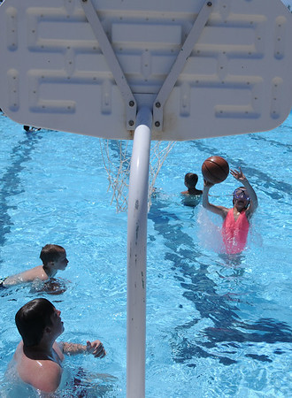 HALEY WARD | THE GOSHEN NEWS<br /> Kids play basketball Wednesday at the Shaklin Pool. The pool is open Monday through Friday noon to 4 p.m. and 6 p.m. to 8 p.m. in the evenings. It is also Saturday and Sunday noon to 7 p.m.
