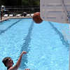 "HALEY WARD | THE GOSHEN NEWS<br /> Austin Peeler, 15, shoots a basket Wednesday at the Shaklin Pool. His mom Jennifer said he loves the pool, and he even walks to the pool by himself. ""He wants to come every day. He loves it,"" she said."