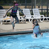 HALEY WARD | THE GOSHEN NEWS<br /> Zoie Miller, 9, and Savannah Buss, 7, hop into the pool Wednesday at the Shaklin Pool.