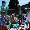 HALEY WARD | THE GOSHEN NEWS<br /> Kids from Discovery Day Camp dry off Wednesday at the Shaklin Pool. The pool opened May 28 and will stay open until July 30.