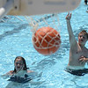 "HALEY WARD | THE GOSHEN NEWS<br /> Jurniee, 13, and Benjamin Peeler, 11, shoot baskets Wednesday at the Shaklin Pool. Even though the weather was in the 70s, their mom Jennifer said it does not bother them.  ""I thought it was a little cold, but they don't care. They love it."" Jennifer Peeler said."