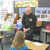 """Photo by Edward Damon/Transcript Staff<br /> Vermont State Representative John Moran kicked off the 2013 Reading Celebration at Stamford Elementary School on Monday morning. Moran read Doreen Cronin's """"Duck for President"""" to first and second grade students in Kristy Sherman's classroom."""